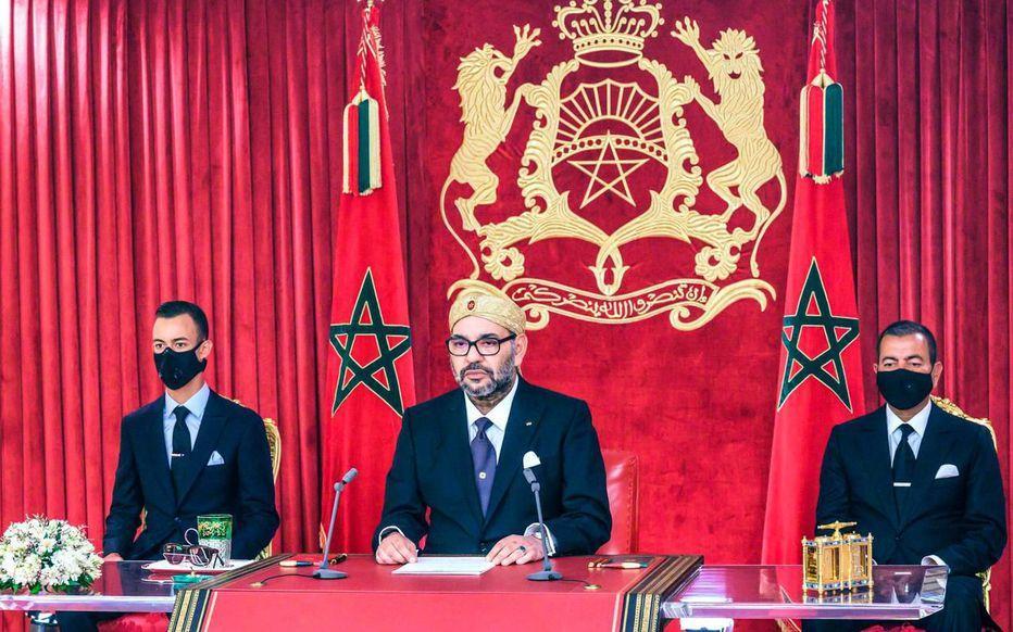 Mohammed Vi et son fils héritier Hassan (gauche)