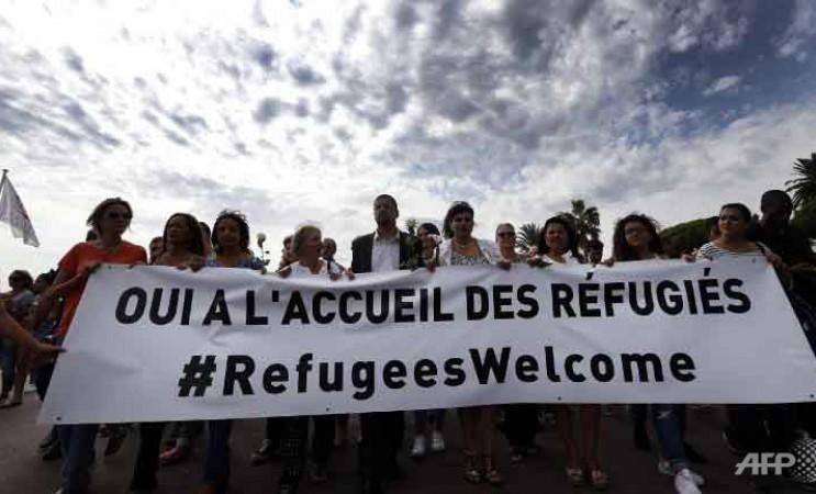 La france accueille les refugies AFP
